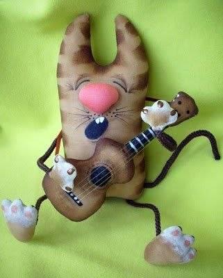 89f702fa0bd3df3059c8efc89b48f2a1 - Игрушка Кот с гитарой