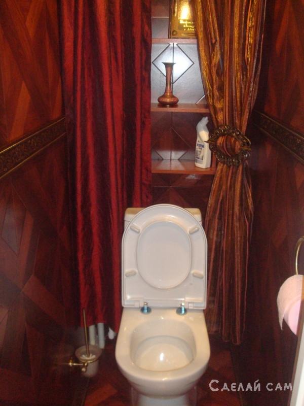 Ремонт туалета - ламинат вместо плитки.